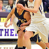 Legacy's Emiley Lopez collides with Boulder's Sarah Burns during Thursday's game at Boulder High.<br /> January 10, 2013<br /> staff photo/ David R. Jennings