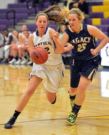 Boulder's Courtney Van Bussum dribbles the ball downcourt against Legacy's Bree Paulson during Thursday's game at Boulder High.<br /> January 10, 2013<br /> staff photo/ David R. Jennings