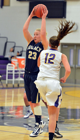 Legacy's Caitlyn Smith catches a pass over  Boulder's Courtney Van Bussum during Thursday's game at Boulder High.<br /> January 10, 2013<br /> staff photo/ David R. Jennings