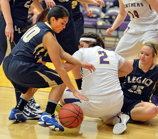 Legacy's Emiley Lopez scrambles after a loose ball behind Boulder's Vivi Gregorich during Thursday's game at Boulder High.<br /> January 10, 2013<br /> staff photo/ David R. Jennings