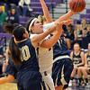 Boulder's Vivi Gregorich goes to the basket against Legacy's Emiley Lopez during Thursday's game at Boulder High.<br /> January 10, 2013<br /> staff photo/ David R. Jennings