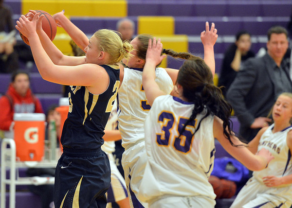 Legacy's Caitlyn Smith reaches for the ball against Boulder's Sarah Burns during Thursday's game at Boulder High.<br /> January 10, 2013<br /> staff photo/ David R. Jennings