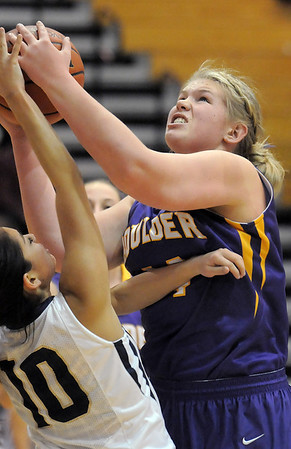 Boulder's Ande Lampert fights for the ball against Legacy's Emiley Lopez during Friday's game at Legacy.<br /> January 6, 2012<br /> staff photo/ David R. Jennings