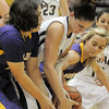 Legacy's Shayna Edwards fights for control of the ball with Boulder's Vivi Gregorich and Jocelyn Trainer during Friday's game at Legacy.<br /> January 6, 2012<br /> staff photo/ David R. Jennings