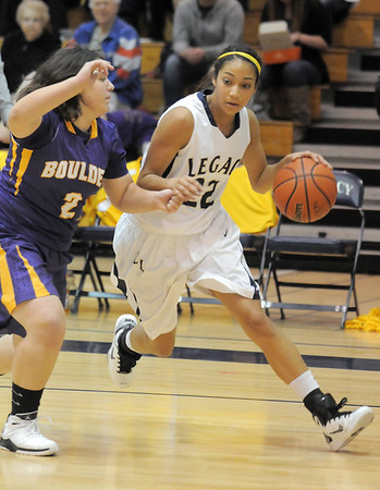 Legacy's Kailey Edwards drives the ball to the basket against Boulder's Vivi Gregorich during Friday's game at Legacy.<br /> January 6, 2012<br /> staff photo/ David R. Jennings