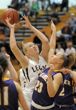Legacy's Caitlyn Smith grabs for the ball against Boulder's Lena Laycox during Friday's game at Legacy.<br /> January 6, 2012<br /> staff photo/ David R. Jennings