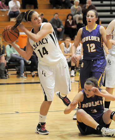 Legacy's Shayna Kuyper looks for an open player to pass over Boulder's Courntey Van Bussum and Sarah Burns during Friday's game at Legacy.<br /> January 6, 2012<br /> staff photo/ David R. Jennings