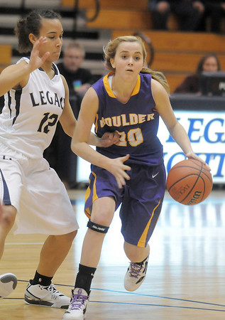 Boulder's Jocelyn Trainer dribbles the ball past Legacy's Mackenzie Neely during Friday's game at Legacy.<br /> January 6, 2012<br /> staff photo/ David R. Jennings