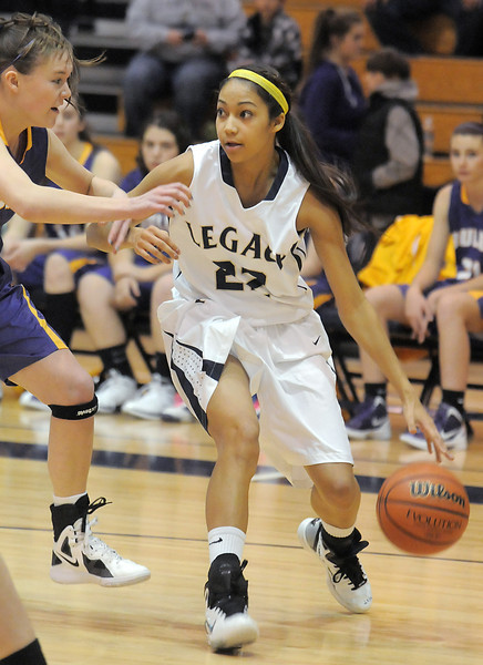 Legacy's Kailey Edwards dribbles the ball against Boulder's Jocelyn Trainer during Friday's game at Legacy.<br /> January 6, 2012<br /> staff photo/ David R. Jennings