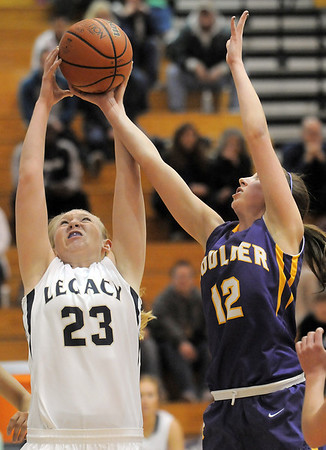 Legacy's Caitlyn Smith teis ti rebound the ball against Boulder's Courtney Van Bussum during Friday's game at Legacy.<br /> January 6, 2012<br /> staff photo/ David R. Jennings