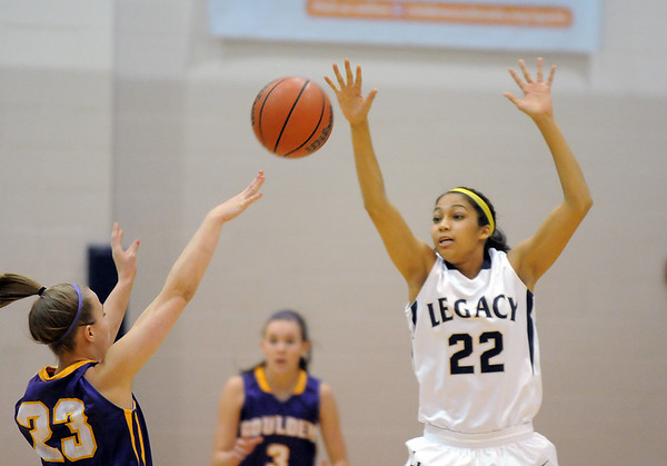 Legacy's Kailey Edwards attempts to block Boulder's Lena Laycox's pass during Friday's game at Legacy.<br /> January 6, 2012<br /> staff photo/ David R. Jennings