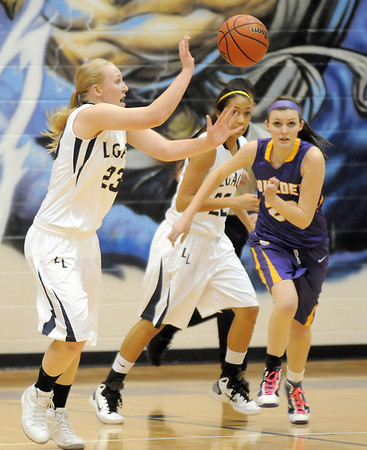 Boulder's Jaqueline Szarmach closes in on Legacy's Caitlyn Smith passing the ball during Friday's game at Legacy.<br /> January 6, 2012<br /> staff photo/ David R. Jennings