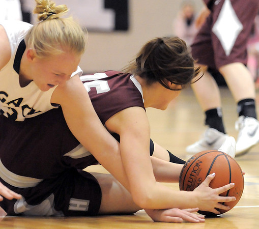 Legacy's Caitlyn Smith fights for the ball against Horizon's Meghan Dyer during Thursday's girls game at Legacy.<br /> February 9, 2012<br /> staff photo/ David R. Jennings