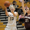 Legacy's Caitlyn Smith goes to the basket against Horizon's Alyssa Rader during Thursday's girls game at Legacy.<br /> February 9, 2012<br /> staff photo/ David R. Jennings