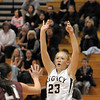 Legacy's Caitlyn Smith shoots the ballover Horizon's Alyssa Rader during Thursday's girls game at Legacy.<br /> February 9, 2012<br /> staff photo/ David R. Jennings