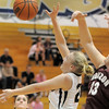 Legacy's Caitlyn Smith goes for a rebound against Horizon's Kaylie Rader during Thursday's girls game at Legacy.<br /> February 9, 2012<br /> staff photo/ David R. Jennings