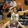 Legacy's Kailey Edwards prepares to pass the ball over  Horizon's Jessca Ramos during Thursday's girls game at Legacy.<br /> February 9, 2012<br /> staff photo/ David R. Jennings