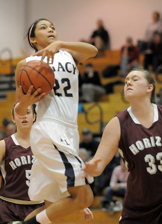 Legacy's Kailey Edwards goes to the basket against Horizon's Kaylie Rader during Thursday's girls game at Legacy.<br /> February 9, 2012<br /> staff photo/ David R. Jennings