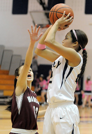 Legacy's Kailey Edwards shoots the ball past Horizon's Gabriela Jimenez during Thursday's girls game at Legacy.<br /> February 9, 2012<br /> staff photo/ David R. Jennings