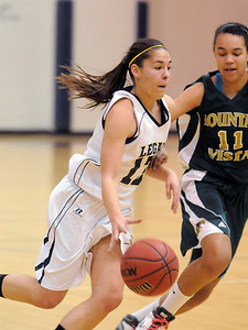 Taylor Archuleta, Legacy, drives the ball to the basket against Mikalah Hughes, Mountain Vista during Friday's 1st round of the state 5A girls playoffs at Legacy. February 25, 2011 staff photo/David R. Jennings