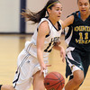 Taylor Archuleta, Legacy, drives the ball to the basket against Mikalah Hughes, Mountain Vista during Friday's 1st round of the state 5A girls playoffs at Legacy.<br /> February 25, 2011<br /> staff photo/David R. Jennings