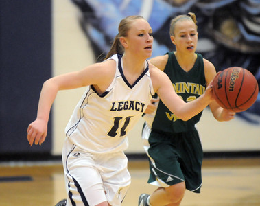 Emily Glen, Legacy, dribbles the ball down court ahead of Lena Jaycox, Mountain Vista during Friday's 1st round of the state 5A girls playoffs at Legacy. February 25, 2011 staff photo/David R. Jennings