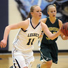 Emily Glen, Legacy, dribbles the ball down court ahead of Lena Jaycox, Mountain Vista during Friday's 1st round of the state 5A girls playoffs at Legacy.<br /> February 25, 2011<br /> staff photo/David R. Jennings