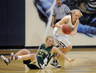 Legacy's Caitlin Smith takes the ball down court after stealing it from Megan Whetstone, Mountain Vista during Friday's 1st round of the state 5A girls playoffs at Legacy. February 25, 2011 staff photo/David R. Jennings