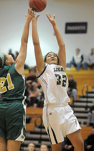 Legacy's Sade Akindele shoots the ball over Jennifer Wahleithner, Mountain Vista during Friday's 1st round of the state 5A girls playoffs at Legacy. February 25, 2011 staff photo/David R. Jennings