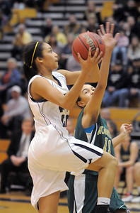 Kailey Edwards, Legacy, goes for a layup against Mikalah Hughes, Mountain Vista during Friday's 1st round of the state 5A girls playoffs at Legacy. February 25, 2011 staff photo/David R. Jennings