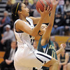 Kailey Edwards, Legacy, goes for a layup against Mikalah Hughes, Mountain Vista during Friday's 1st round of the state 5A girls playoffs at Legacy.<br /> February 25, 2011<br /> staff photo/David R. Jennings