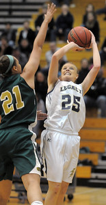 Sara Dunahay, Legacy, shoots past the reaches of Jennifer Wahleithner, Mountain Vista during Friday's 1st round of the state 5A girls playoffs at Legacy. February 25, 2011 staff photo/David R. Jennings