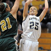Sara Dunahay, Legacy, shoots past the reaches of Jennifer Wahleithner, Mountain Vista during Friday's 1st round of the state 5A girls playoffs at Legacy.<br /> February 25, 2011<br /> staff photo/David R. Jennings