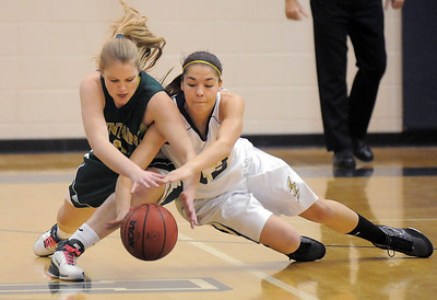 Taylor Archuleta, Legacy, fights to recover a loose ball with Megan Whetstone, Mountain Vista during Friday's 1st round of the state 5A girls playoffs at Legacy. February 25, 2011 staff photo/David R. Jennings