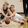 Taylor Archuleta, Legacy, fights to recover a loose ball with Megan Whetstone, Mountain Vista during Friday's 1st round of the state 5A girls playoffs at Legacy.<br /> February 25, 2011<br /> staff photo/David R. Jennings