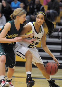 Kailey Edwards,  Legacy, dribbles the ball to the basket against Grace Shea, Mountain Vista during Friday's 1st round of the state 5A girls playoffs at Legacy. February 25, 2011 staff photo/David R. Jennings