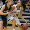 Kailey Edwards,  Legacy, dribbles the ball to the basket against Grace Shea, Mountain Vista during Friday's 1st round of the state 5A girls playoffs at Legacy.<br /> February 25, 2011<br /> staff photo/David R. Jennings