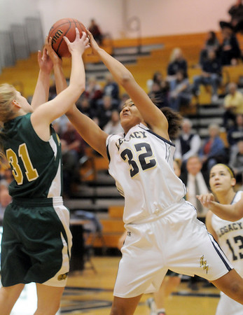 Sade Akindele, Legacy, fights to retrieve a rebound with Megan Whetstone, Mountain Vista during Friday's 1st round of the state 5A girls playoffs at Legacy.<br /> February 25, 2011<br /> staff photo/David R. Jennings