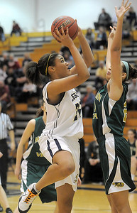 Sade Akindele, Legacy, shoots to the basket past Jennifer Wahleithner, Mountain Vista during Friday's 1st round of the state 5A girls playoffs at Legacy. February 25, 2011 staff photo/David R. Jennings
