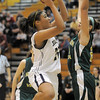 Sade Akindele, Legacy, shoots to the basket past Jennifer Wahleithner, Mountain Vista during Friday's 1st round of the state 5A girls playoffs at Legacy.<br /> February 25, 2011<br /> staff photo/David R. Jennings