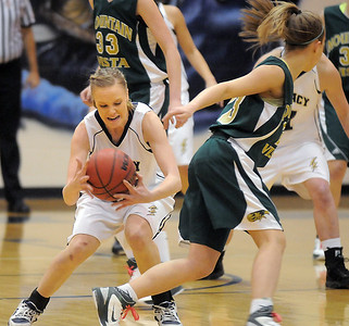Sara Dunahay, Legacy, steals the ball from Lena Jaycox, Mountain Vista during Friday's 1st round of the state 5A girls playoffs at Legacy. February 25, 2011 staff photo/David R. Jennings