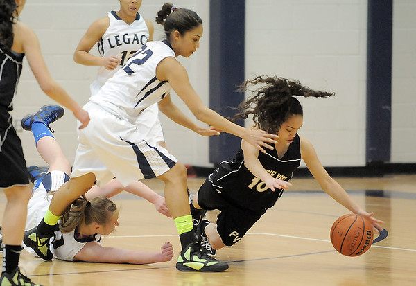 Legacy's Kailey Edwads and Emily Glen, left, and Prairie View's Halley Lind scramble after a loose ball during Saturday's state 5A playoff game at Legacy.<br /> February 24, 2012 <br /> staff photo/ David R. Jennings
