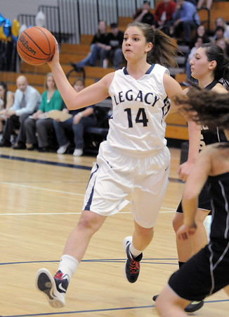 Legacy's Shayna Kuyper passes the ball during Saturday's state 5A playoff game against Prairie View at Legacy.<br /> February 24, 2012 <br /> staff photo/ David R. Jennings