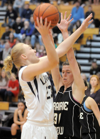 Legacy's Caitlyn Smith, left,  goes to the basket against Prairie View's Lindsey Wittington during Saturday's state 5A playoff game at Legacy.<br /> February 24, 2012 <br /> staff photo/ David R. Jennings