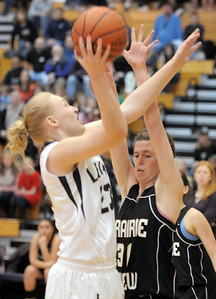 Legacy's Caitlyn Smith, left,  goes to the basket against Prairie View's Lindsey Wittington during Saturday's state 5A playoff game at Legacy. February 24, 2012  staff photo/ David R. Jennings