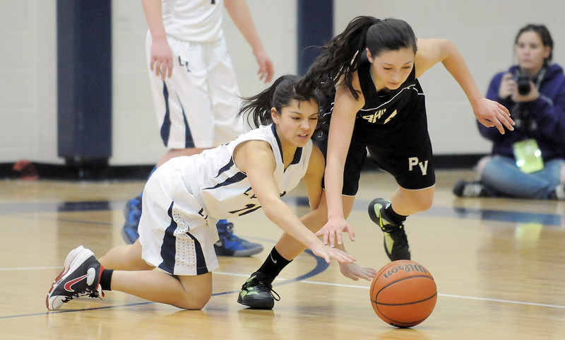 Legacy's Mackenzie Neeley fights for possession of a loose ball with Prairie View's Halley Lind during Saturday's state 5A playoff game at Legacy.<br /> February 24, 2012 <br /> staff photo/ David R. Jennings