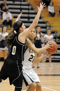 Legacy's Kailey Edwards, right, moves the ball against Prairie View's Karissa Cardenas during Saturday's state 5A playoff game at Legacy. February 24, 2012  staff photo/ David R. Jennings