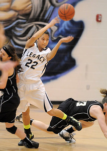Legacy's Kailey Edwards passes the ball while colliding with Prarie View's Karissa Cardenas and Jade Morton during Saturday's state 5A playoff game at Legacy. February 24, 2012  staff photo/ David R. Jennings