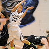Legacy's Kailey Edwards passes the ball while colliding with Prarie View's Karissa Cardenas and Jade Morton during Saturday's state 5A playoff game at Legacy.<br /> February 24, 2012 <br /> staff photo/ David R. Jennings