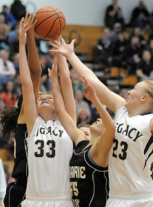 Legacy's Courtney Smith, left, reaches for the ball with Caitlyn Smith, right, against Prairie View's Cierra Mendoza during Saturday's state 5A playoff game at Legacy. February 24, 2012  staff photo/ David R. Jennings